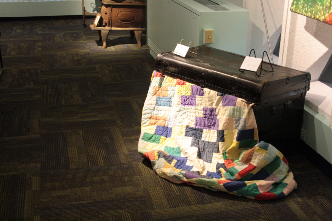Pullman Trunk and Patchwork Quilt