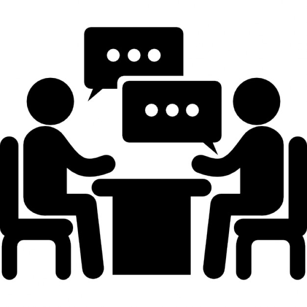 People talking at a table